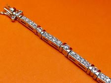 "Picture of ""Channels of Zirconia"" tennis bracelet in sterling silver with bezel set cubic zirconia and channels"