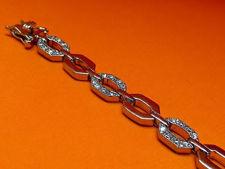 """Afbeelding van """"Achthoekige schakel"""" armband in sterling zilver waarbij elke tweede schakel ingelegd is met ronde kubiek zirkonia"""