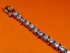 "Picture of ""Zirconia Slash Zirconia"" tennis bracelet in sterling silver, a row of prong set round cubic zirconia interspersed with forward slashes"