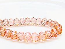 Picture of 7x10 mm, carved cruller beads, Czech, transparent, light topaz pink luster