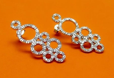 """Picture of """"Zirconia bubbles"""" earrings in sterling silver, a cluster of seven circles encrusted with round cubic zirconia"""