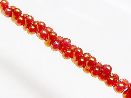 Picture of 2x4 mm, Japanese peanut-shaped seed beads, opaque, rose gold luster