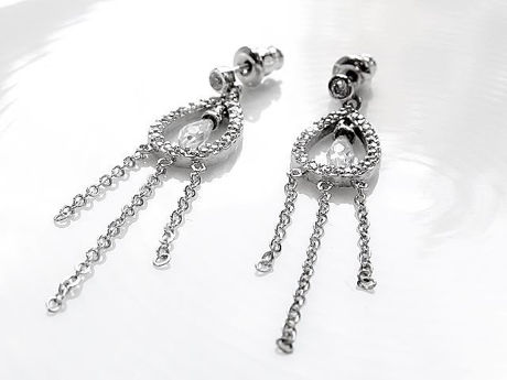 "Picture of ""Framed crystal drop"" earrings in sterling silver,  a crystal drop suspended in a tear-shaped loop with CZ"